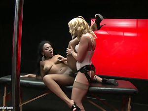 tough Kathia Nobili pushes her strap on salami deep down her colleague jaws