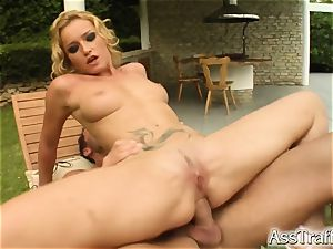 backside Traffic Caty's cock-squeezing ass gets tongued and plumbed