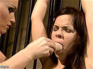 Kathia Nobili makes a steaming stunner suck a faux-cock