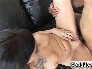 Firefighter Vanessa slips down the black pole