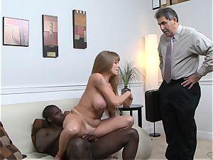 Darla Crane nails dark-hued trunk before her husband cleans up
